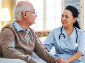 senior man and a nurse talking