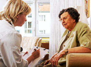 doctor having an assessment to an old patient