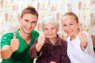 elderly woman with the sweet young caregivers