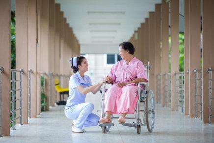 lady caregiver helping senior woman