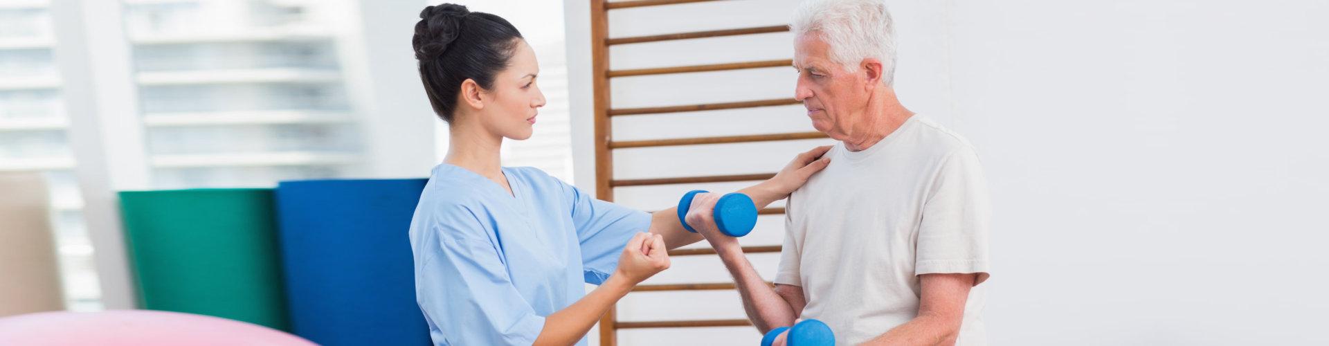lady caregiver assisting senior man